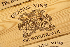 Bordeaux wine label. Close up of Bordeaux wine label on wooden boxes stock images