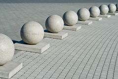 Border. Architectural elements on a city square. A protection from spheres Royalty Free Stock Photo