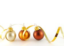 Border. Three christmas balls with gold ribbon on the white background stock photos