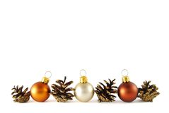 Border. Three christmas balls with cones like a border on the white background stock images