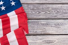 Border from American flag, horizontal image. United States of America flag draped as a border with a old wooden background and copy space Royalty Free Stock Photos