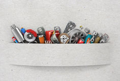 Border of auto parts on paper background Stock Photos