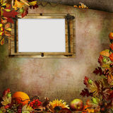 Border of autumn leaves, berries and frame on a green vintage background Stock Photos