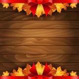 Border of autumn maples leaves decorated with a red bow Stock Images