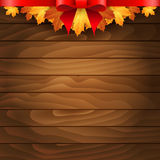 Border of autumn maples leaves on a wooden background. Royalty Free Stock Photography