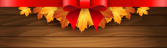 Border of autumn maples leaves on a wooden background. Royalty Free Stock Image