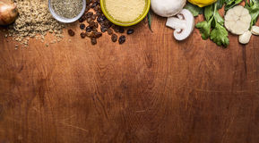 Border with autumn vegetables, mushrooms and nuts raisin couscous mushrooms herbs and garlic  rustic wooden background top view Stock Photography