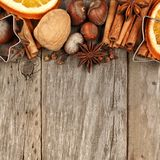 Border of baking ingredients and holiday spices over rustic wood Royalty Free Stock Images
