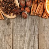 Border of baking ingredients and holiday spices over rustic wood Stock Images