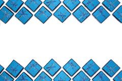 Border of blue shiny gifts isolated on white background. New Year`s decorations. Stock Photos