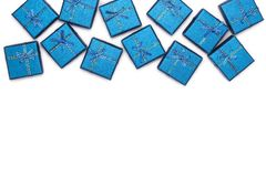 Border of blue shiny gifts  on white background. New Year`s decorations. Stock Photos