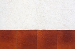 Border of brown tiles. A fragment of stucco wall with a border of brown tiles Royalty Free Stock Image
