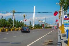 Border checkpoint at Khorgos, China. KHORGOS, CHINA - JULY 7: Taxi passing towards border checkpoint between Kazakhstan and China. July 2016 stock images