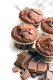 Border of chocolate muffins Stock Photography
