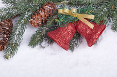 Border of Christmas Bells, Evergreen Branch and Pine Cones Stock Image