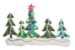 Border from  Christmas  fir trees. Border from  Christmas New Years snow forest fir trees- clay plasticine handmade children collage. Isolated Royalty Free Stock Photos