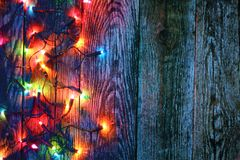 Border of christmas lights. On wooden background royalty free stock photography