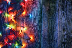 Border of christmas lights. On wooden background royalty free stock image