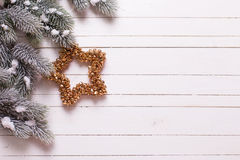 Border from christmas star and branches fur tree on  wooden back Royalty Free Stock Image