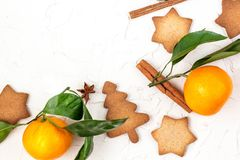 Border of Christmas star cookies with spices and mandarin on white background with copyspace. Top view royalty free stock photography