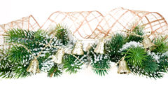 Border from Christmas tree branch and bells. Border from Christmas tree branch and decorations on white background Stock Images
