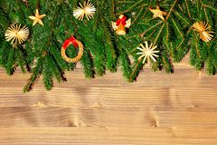 Border with Christmas tree branches and decorations. Copy space for text royalty free stock photos