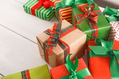 Border of colored packages with red, green ribbons, closeup Stock Photo