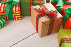 Border of colored packages with red, green ribbons, closeup Royalty Free Stock Photography
