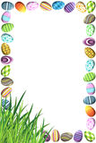 Border with Colorful Easter Eggs. A border made of colorful easter eggs in different patterns and grass in the bottom left corner Royalty Free Stock Images
