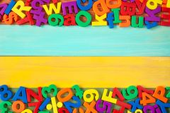 Border of colorful fridge magnets Stock Images
