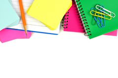 Border of colorful notebooks and school supplies Royalty Free Stock Photos