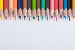 Border of colorful pencil crayons. Viewed in colorful artistic display with copyspace Stock Photo