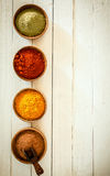Border of colourful spices Stock Photography