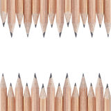 Border composition from natural wooden pencils Royalty Free Stock Photography