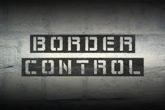 Border control gr. Border control stencil print on the grunge white brick wall stock photo