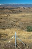 Border country. The last barbed wire fence before the open lands of Lesotho Royalty Free Stock Photography