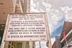Border cross checkpoint Charlie in Berlin. BERLIN, GERMANY - JUNE 10: former border cross checkpoint Point Charlie on June 10, 2013 in Berlin. It's the best stock photo