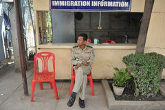 Border Crossing. A border policeman mans an immigration post at an overland border on July 10, 2012 in Poipet, Cambodia. In 2011 Cambodia saw 2.9m visitors, up Stock Photos
