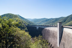 Border of dam. Concrete tall barrier of big dam in Thailand, surround by green mountain royalty free stock image