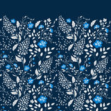The border of delicate little blue and white flowers on navy blue background from above. Flat lay style. The border of delicate little blue and white flowers on Royalty Free Stock Photo