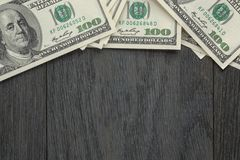 Border from dollar bills on wooden table Royalty Free Stock Photography