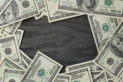Border from dollar bills on wooden table Stock Photography