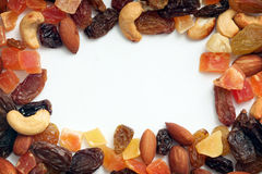 Border of dried fruits and nuts. Frame of dried fruits and nuts isolated on white stock images