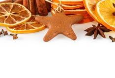 Border of dried oranges, lemons, mandarins, star anise, cinnamon sticks and gingerbread, isolated on white Stock Photo