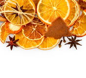 Border of dried oranges, lemons, mandarins, star anise, cinnamon sticks and gingerbread, isolated on white Stock Photography