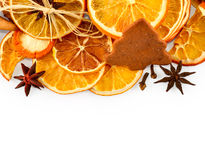 Border of dried oranges, lemons, mandarins, star anise, cinnamon sticks and gingerbread, isolated on white Royalty Free Stock Photos