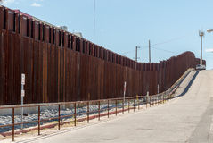 The border fence between Arizona and Mexico. Looking along the border fence in Nogales Arizona Royalty Free Stock Photo