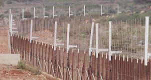 Border fence between Israel and Lebanon. barbed wire and electronic fence. Border between Israel and Lebanon. barbed wire and electronic fence