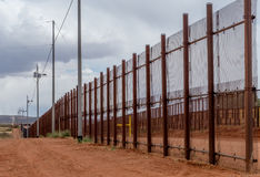 Border fence separating Mexico from the United States at Naco Arizona. Looking across the border fence from Naco Arizona into Mexico Stock Image