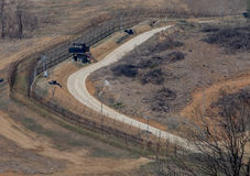 The border fence separating North and South Korea with guard tower. The fence that separates North and South Korea in the de-militarized zone along the 38th Stock Images